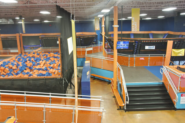 Sky Zone trampoline park interior with ball pit